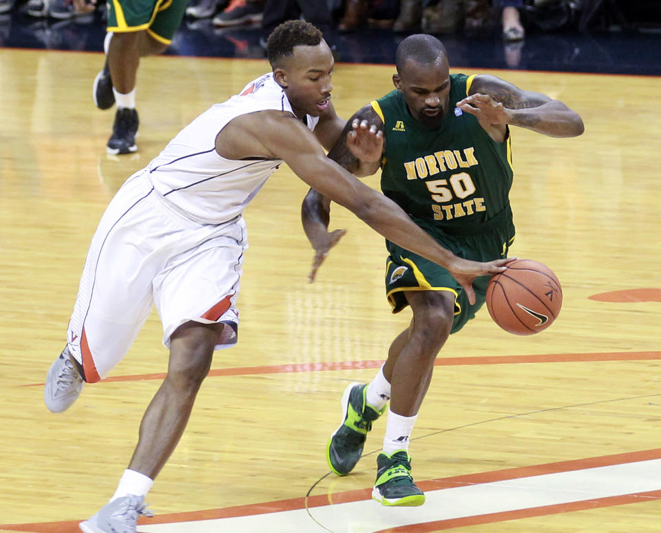 Virginia forward Darion Atkins (5) steals the ball away from Norfolk State forward LaTre'e Russell (50) during an NCAA college basketball game, Sunday Nov. 16, 2014 in Charlottesville, Va. (AP Photo/Andrew Shurtleff)