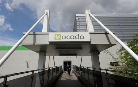FILE PHOTO: A man walks from the main reception of the Ocado CFC (Customer Fulfilment Centre) in Andover
