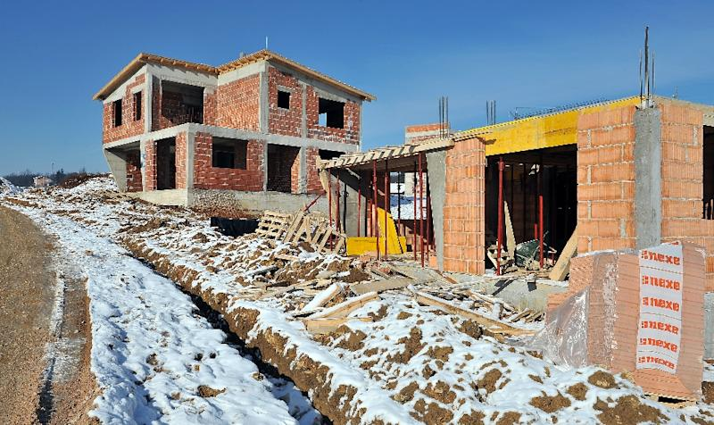 A picture taken on January 19, 2016 shows several houses under construction in Sarajevo's suburban area of Blazuj. (AFP Photo/Elvis Barukcic)