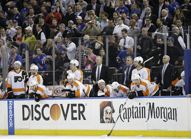 Philadelphia Flyers' Brayden Schenn (10), Matt Read (24), Jason Akeson (42) and Adam Hall (18) watch with teammates during the third period in Game 7 of an NHL hockey first-round playoff series against the New York Rangers, Wednesday, April 30, 2014, in New York. The Rangers won the game 2-1. (AP Photo)