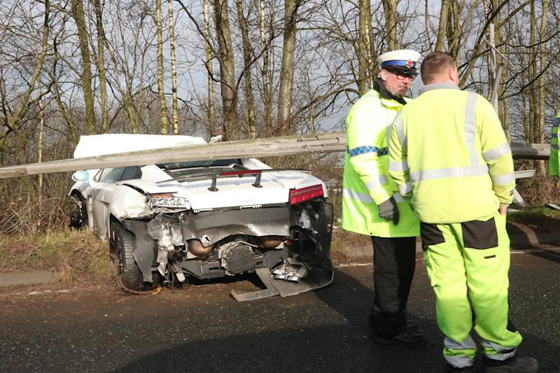 Wreckage: The white Lamborghini at the side of the road (Eamonn and James Clarke)