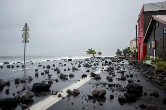<p>Rocks lay swept by strong waves onto a road in Le Carbet, on the French Caribbean island of Martinique, after it was hit by Hurricane Maria, on Sept. 19, 2017. (Photo: Lionel Chamoiseau/AFP/Getty Images) </p>