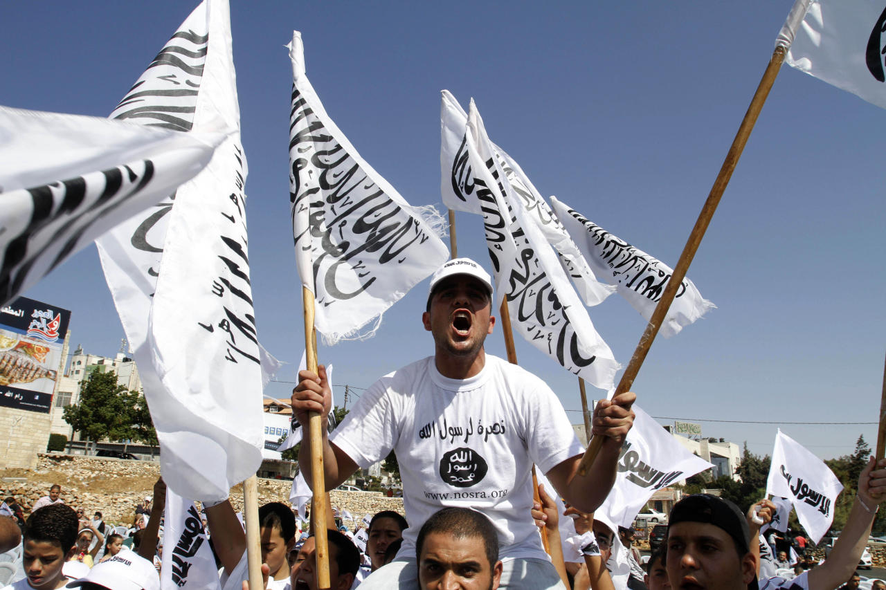 "Palestinians chant anti-U.S. slogans during a protest against an anti-Islam film called ""Innocence of Muslims"" that ridicules Islam's Prophet Muhammad, in the West Bank city of Ramallah, Friday, Sept. 21, 2012. (AP Photo/Nasser Shiyoukhi)"