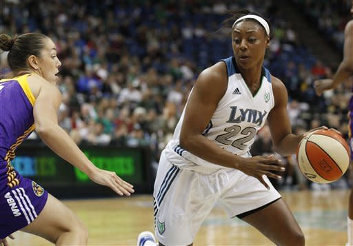 Minnesota Lynx guard Monica Wright (22) drives the ball around Los Angeles Sparks guard Jenna O'Hea (6) in the first half of Game 1 of the WNBA basketball Western Conference Finals Thursday, Oct. 4, 2012, in Minneapolis. (AP Photo/Stacy Bengs)