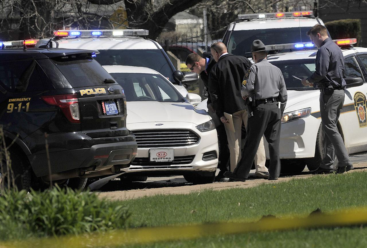 <p>Pennsylvania State Police look over a car as they investigate the scene where Steve Stephens, the suspect in the random killing of a Cleveland retiree posted on Facebook, was found shot dead, April 18, 2017, in Erie. Pa. Acting on a tip, Pennsylvania State Police spotted Stephens, 37, in Erie County, in the state's northwest corner, and went after him. After a brief chase, he took his own life, authorities said.(Photo: Greg Wohlford/Erie Times-News/AP) </p>