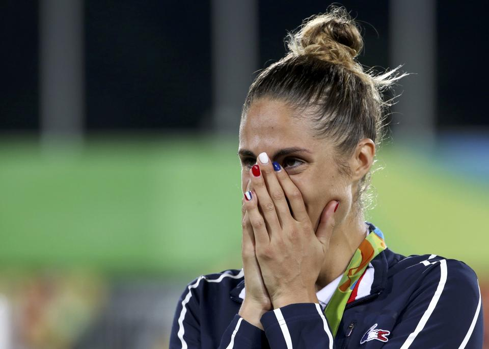 2016 Rio Olympics - Modern Pentathlon - Victory Ceremony - Women's Victory Ceremony - Deodoro Stadium - Rio de Janeiro, Brazil - 19/08/2016. Silver medalist Elodie Clouvel (FRA) of France reacts. REUTERS/Edgard Garrido  FOR EDITORIAL USE ONLY. NOT FOR SALE FOR MARKETING OR ADVERTISING CAMPAIGNS.