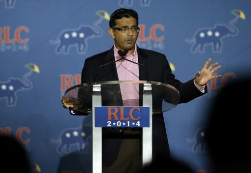 President Donald Trump says he will issue a pardon to conservative author Dinesh D'Souza, who pleaded guilty in 2014 to making an illegal campaign contribution