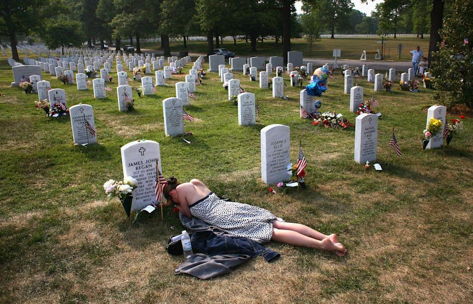 <p>2007. Getty Caption: Mary McHugh mourns her slain fiance Sgt. James Regan at 'Section 60' of the Arlington National Cemetery May 27, 2007. Regan, a US Army Ranger, was killed by an IED explosion in Iraq in February of this year, and this was the first time McHugh had visited the grave since the funeral. Section 60, the newest portion of the vast national cemetery on the outskirts of Washington D.C, contains hundreds of U.S. soldiers killed in Iraq and Afghanistan</p>