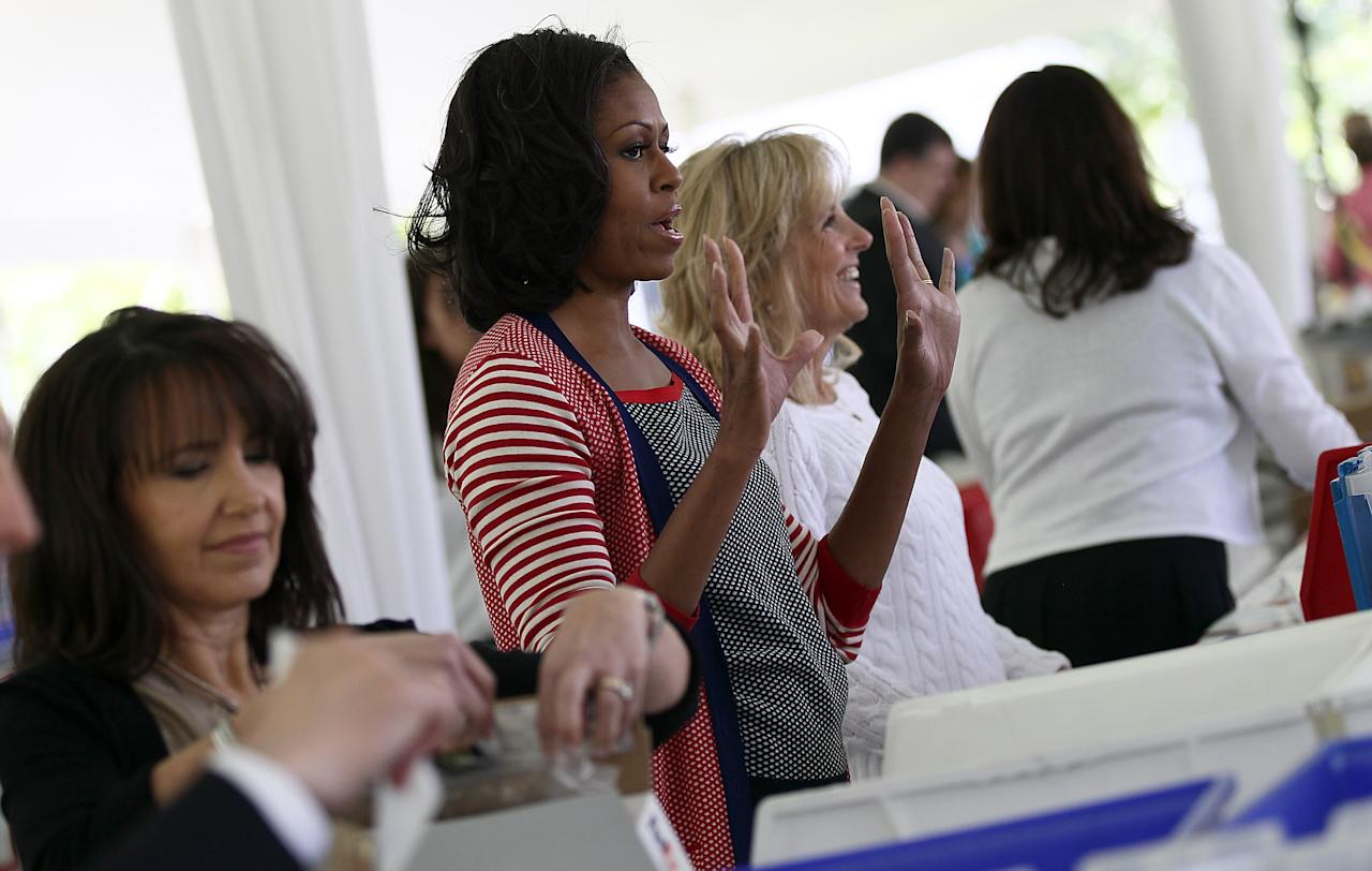 WASHINGTON, DC - MAY 10:  First Lady Michelle Obama a(2nd L) nd Dr. Jill Biden (2nd R), the wife of U.S. Vice President Joe Biden, participate in a Joining Forces service event at the Vice President's residence at the Naval Observatory May 10, 2012 in Washington, DC. Obama and Biden joined with Congressional spouses to assemble Mother's Day packages that deployed troops have requested to be sent to their mothers and wives at home.  (Photo by Win McNamee/Getty Images)