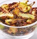 """<p>Though the 10 year old version of ourselves would be shocked to hear it, we can't get enough of <a href=""""https://www.delish.com/uk/cooking/recipes/g33860559/brussel-sprouts-recipe/"""" rel=""""nofollow noopener"""" target=""""_blank"""" data-ylk=""""slk:Brussels sprouts"""" class=""""link rapid-noclick-resp"""">Brussels sprouts</a>. Not only are they are favourite veggie side, they're now our favourite salty, crunchy snack! We love this garlic-parm variety dipped in caesar dressing, but Ranch wouldn't be a bad idea either. 😉 </p><p>Get the <a href=""""https://www.delish.com/uk/cooking/recipes/a34665643/best-brussels-sprout-chips-recipe/"""" rel=""""nofollow noopener"""" target=""""_blank"""" data-ylk=""""slk:Air Fryer Brussels Sprout Crisps"""" class=""""link rapid-noclick-resp"""">Air Fryer Brussels Sprout Crisps</a> recipe.</p>"""