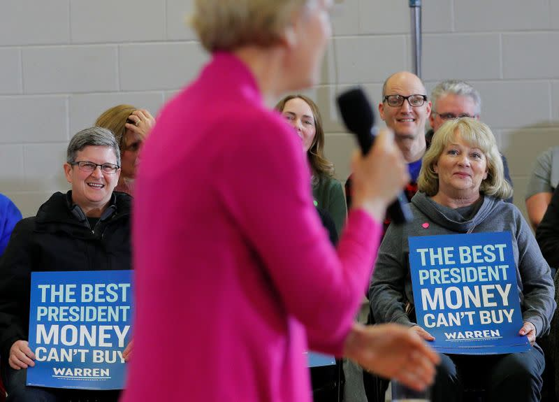 Audience members listen as Democratic 2020 U.S. presidential candidate Warren speaks at a campaign town hall meeting in Muscatine