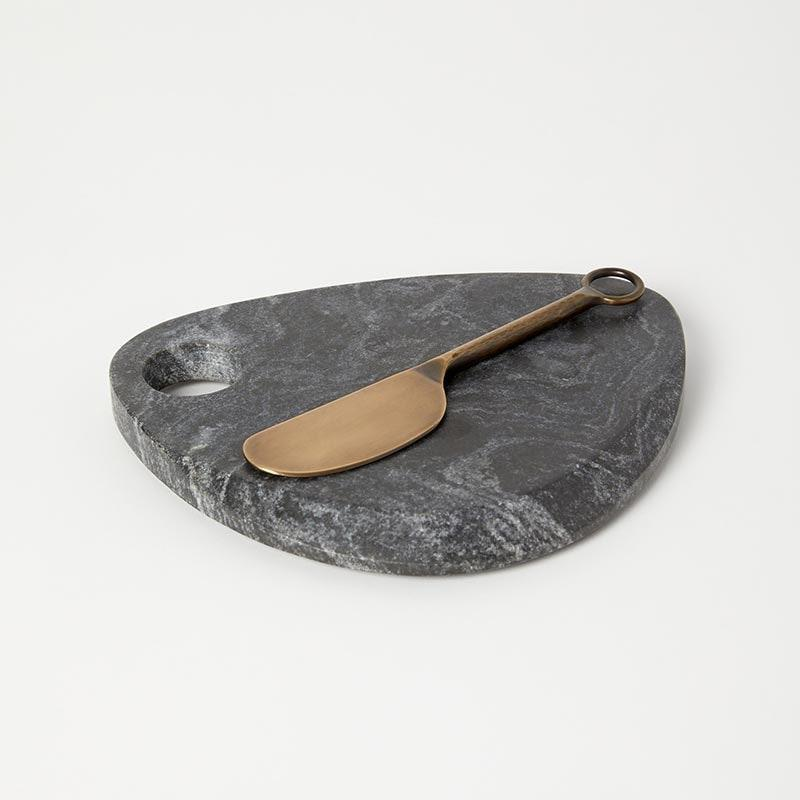 "Impress the cheese-board enthusiast with this marble tray that will have their charcuterie looking cuter than ever. $28, Verishop. <a href=""https://www.verishop.com/floor-9/serving-board/small-marble-board-spreader/p4167254900759"" rel=""nofollow noopener"" target=""_blank"" data-ylk=""slk:Get it now!"" class=""link rapid-noclick-resp"">Get it now!</a>"