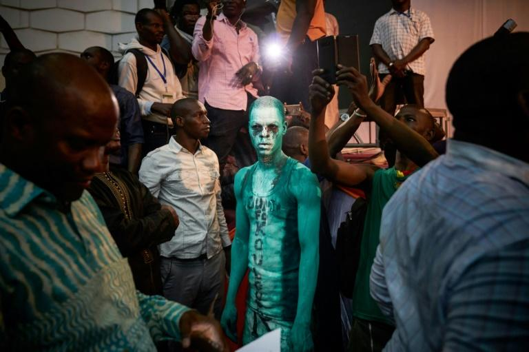Painted protest: A Cisse supporter attends a rally to condemn alleged vote rigging