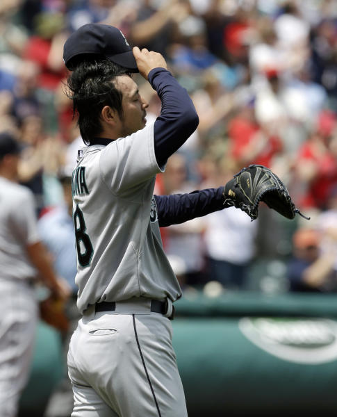 Seattle Mariners starting pitcher Hisashi Iwakuma reacts as he waits for Cleveland Indians' Ryan Raburn to run the bases after Raburn hit a three-run home run in the second inning of a baseball game, Monday, May 20, 2013, in Cleveland. Carlos Santana and Michael Brantley scored. (AP Photo/Tony Dejak)