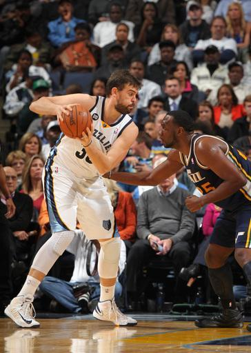 MEMPHIS, TN - NOVEMBER 5: Marc Gasol #33 of the Memphis Grizzlies controls the ball against Al Jefferson #25 of the Utah Jazz on November 5, 2012 at FedExForum in Memphis, Tennessee. (Photo by Joe Murphy/NBAE via Getty Images)