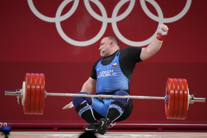 <p>Jiri Orsag of Czech Republic falls as he competes in the men's +109kg weightlifting event, at the 2020 Summer Olympics, Wednesday, Aug. 4, 2021, in Tokyo, Japan. (AP Photo/Luca Bruno)</p>