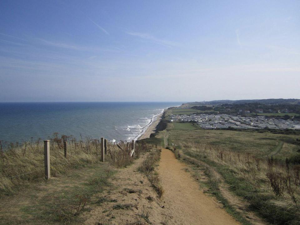 """<p>Both of these beaches boast Blue Flag status, and East Runton is the most family-friendly of the two. West Runton is part of the Deep History Coast and is great for fossil hunting; it's famously where the oldest and largest mammoth skeleton was discovered back in 1990. It's also brilliant for dog walking and rock pooling.</p><p><strong>Where to stay:</strong> <a href=""""https://go.redirectingat.com?id=127X1599956&url=https%3A%2F%2Fwww.booking.com%2Fhotel%2Fgb%2Fsea-marge.en-gb.html%3Faid%3D2070936%26label%3Dnorfolk-beaches&sref=https%3A%2F%2Fwww.redonline.co.uk%2Ftravel%2Ftravel-guides%2Fg34735930%2Fnorfolk-beaches%2F"""" rel=""""nofollow noopener"""" target=""""_blank"""" data-ylk=""""slk:The Seamarge"""" class=""""link rapid-noclick-resp"""">The Seamarge</a> is a traditional country house hotel set in four acres of gardens on a clifftop with sea views. It's perfectly located for visiting the Runtons as well as Cromer Beach.</p><p><a class=""""link rapid-noclick-resp"""" href=""""https://go.redirectingat.com?id=127X1599956&url=https%3A%2F%2Fwww.booking.com%2Fhotel%2Fgb%2Fsea-marge.en-gb.html%3Faid%3D2070936%26label%3Dnorfolk-beaches&sref=https%3A%2F%2Fwww.redonline.co.uk%2Ftravel%2Ftravel-guides%2Fg34735930%2Fnorfolk-beaches%2F"""" rel=""""nofollow noopener"""" target=""""_blank"""" data-ylk=""""slk:CHECK AVAILABILITY"""">CHECK AVAILABILITY </a></p>"""