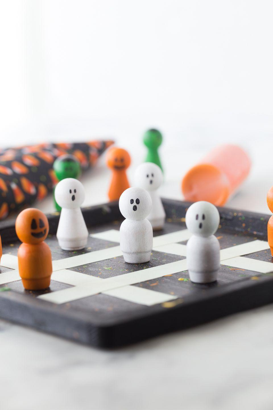 "<p>Kids will be entertained for hours with this Halloween-themed tic-tac-toe game they can make from scratch using a wooden tray and peg dolls found at the craft store. </p><p><strong>Get the tutorial at <a href=""https://www.madetobeamomma.com/halloween-tic-tac-toe/"" rel=""nofollow noopener"" target=""_blank"" data-ylk=""slk:Made to be a Momma"" class=""link rapid-noclick-resp"">Made to be a Momma</a>.</strong></p><p><a class=""link rapid-noclick-resp"" href=""https://www.amazon.com/Woodpeckers-Decorative-Wooden-Doll-People/dp/B00WQDTTCE/?tag=syn-yahoo-20&ascsubtag=%5Bartid%7C10050.g.4950%5Bsrc%7Cyahoo-us"" rel=""nofollow noopener"" target=""_blank"" data-ylk=""slk:SHOP PEG DOLLS"">SHOP PEG DOLLS</a><br></p>"