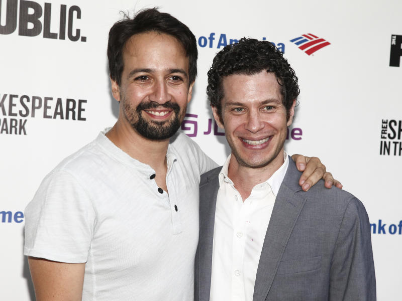 """FILE - In this July 31, 2018 file photo, Lin-Manuel Miranda, left, and Thomas Kail attend the opening night of the Shakespeare in the Park production of Public Works' """"Twelfth Night"""" in New York. A filmed version of Kail and Miranda's original Broadway production """"Hamilton"""" will be available Friday, July 3, on Disney Plus. (Photo by Andy Kropa/Invision/AP, File)"""