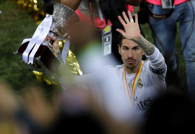 Real Madrid's Sergio Ramos celebrates with the trophy after they beat Atletico Madrid in the Spanish Super Cup Final soccer match at King Abdullah stadium in Jiddah, Saudi Arabia, Monday, Jan. 13, 2020. (AP Photo/Amr Nabil)