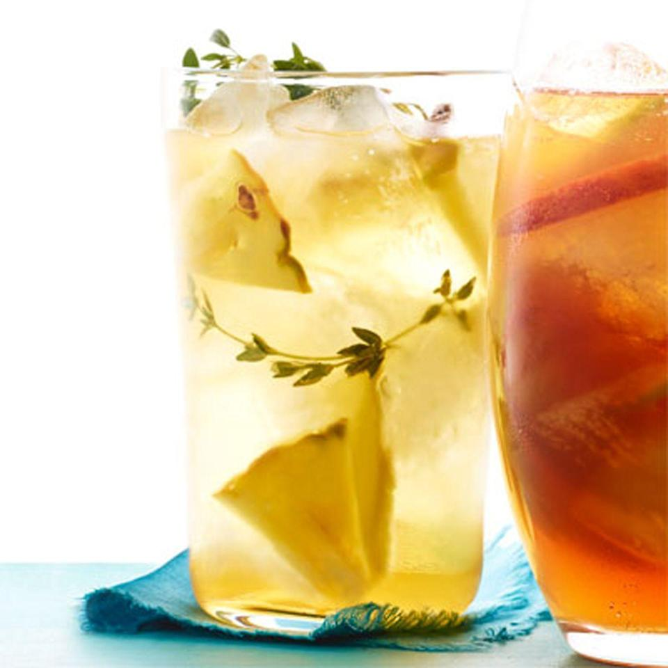 "<p>With just a hint of thyme and pineapple, both you and your guests will be wowed by this delicate and delectable drink. </p><p><strong><em><a href=""https://www.womansday.com/food-recipes/food-drinks/recipes/a12110/pineapple-thyme-iced-tea-recipe-wdy0613/"" rel=""nofollow noopener"" target=""_blank"" data-ylk=""slk:Get the recipe for Pineapple and Thyme Iced Tea"" class=""link rapid-noclick-resp"">Get the recipe for Pineapple and Thyme Iced Tea</a>.</em></strong></p>"
