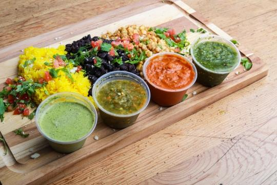 Various vegetable and fruit dips on a board