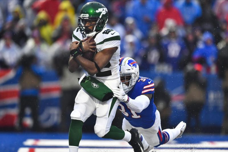 New York Jets wide receiver Jamison Crowder (82) catches a pass for a touchdown in front of Buffalo Bills' Dean Marlowe (31) during the second half of an NFL football game Sunday, Dec. 29, 2019 in Orchard Park, N.Y. (AP Photo/Adrian Kraus)