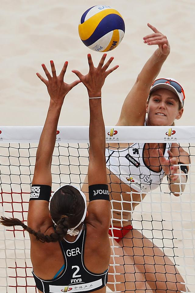 BEIJING, CHINA - MAY 09:  April Ross (R) of the United States in action during a 2012 Swatch FIVB World Tour Beijing Grand Slam preliminary match in Chaoyang Park on May 9, 2012 in Beijing, China.  (Photo by Lintao Zhang/Getty Images)