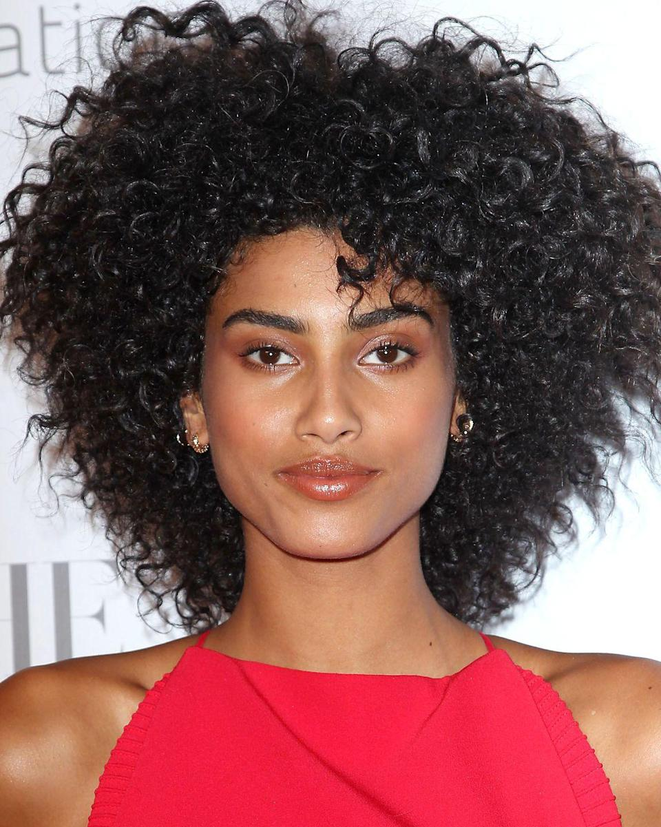 <p>Tight curls in a structured cut look epic for a night out out.</p>