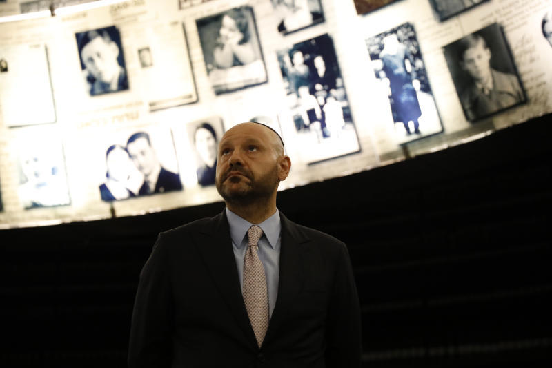 Lebanese-born Swiss real estate mogul Abdallah Chatila, who purchased Nazi memorabilia at a German auction and is donating the items to Israel, visits at the Hall of Names in Yad Vashem in Jerusalem, Sunday, Dec. 8, 2019. Chatila, a Lebanese Christian who has lived in Switzerland for decades, paid some 600,000 euros ($660,000) for the items at the Munich auction last month, intending to destroy them after reading of Jewish groups' objections to the sale. Shortly before the auction, however, he decided it would be better to donate them to a Jewish organization. (AP Photo/Ariel Schalit)