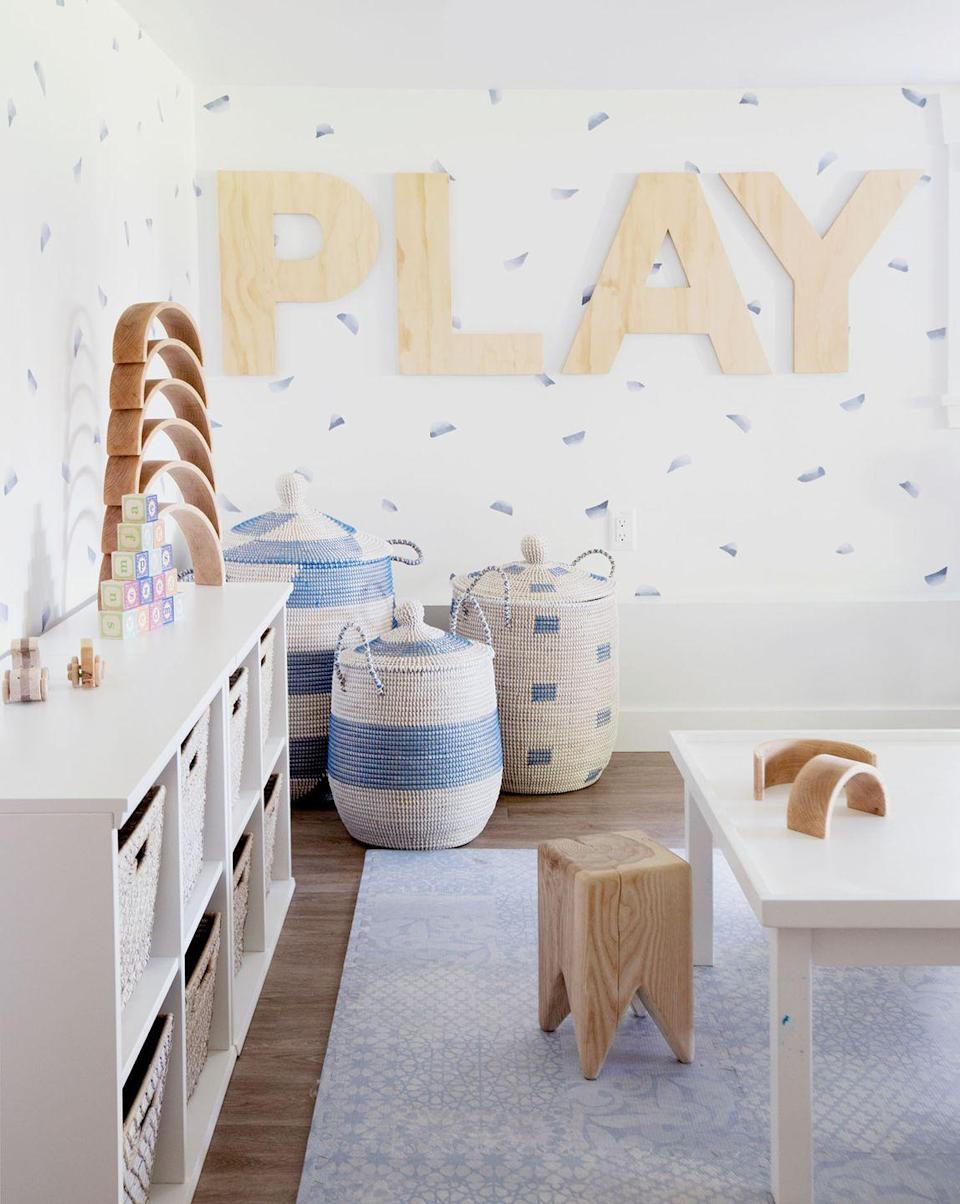 """<p>Have you ever seen a more soothing playroom? The secret lies in the cool blue and white color palette—and in hiding unsightly toys in pretty wicker storage baskets. Round out this bright, fresh look with a baby blue foam playmat that's as sweet as it is functional.</p><p><strong>See more at <a href=""""http://www.winterdaisy.com/blog/2019/1/9/bright-fresh-modern-basement-playroom"""" rel=""""nofollow noopener"""" target=""""_blank"""" data-ylk=""""slk:Winter Daisy"""" class=""""link rapid-noclick-resp"""">Winter Daisy</a>. </strong></p><p><a class=""""link rapid-noclick-resp"""" href=""""https://go.redirectingat.com?id=74968X1596630&url=https%3A%2F%2Fwww.walmart.com%2Fip%2FCustom-Wooden-Letter-6-Monotype-L-Wall-Letters-Unpainted-Craft%2F818097245&sref=https%3A%2F%2Fwww.thepioneerwoman.com%2Fhome-lifestyle%2Fdecorating-ideas%2Fg34763691%2Fbasement-ideas%2F"""" rel=""""nofollow noopener"""" target=""""_blank"""" data-ylk=""""slk:SHOP WALL LETTERS"""">SHOP WALL LETTERS</a></p>"""