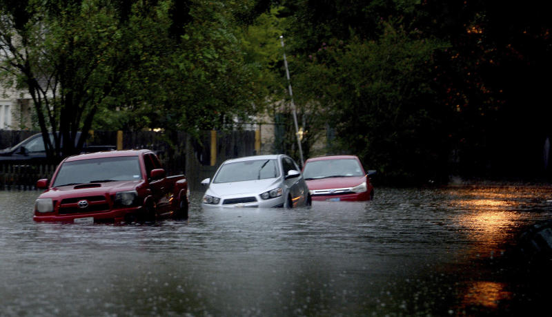 Streets in Old Town are flooded as heavy storm bands continue to batter the region Thursday morning, Sept. 19, 2019, in Beaumont, Texas. The remnants of Tropical Storm Imelda unleashed torrential rains in parts of Texas, prompting hundreds of water rescues, a hospital evacuation and road closures as the powerful storm system quickly drew comparisons to 2017's Hurricane Harvey. (Kim Brent/The Beaumont Enterprise via AP)
