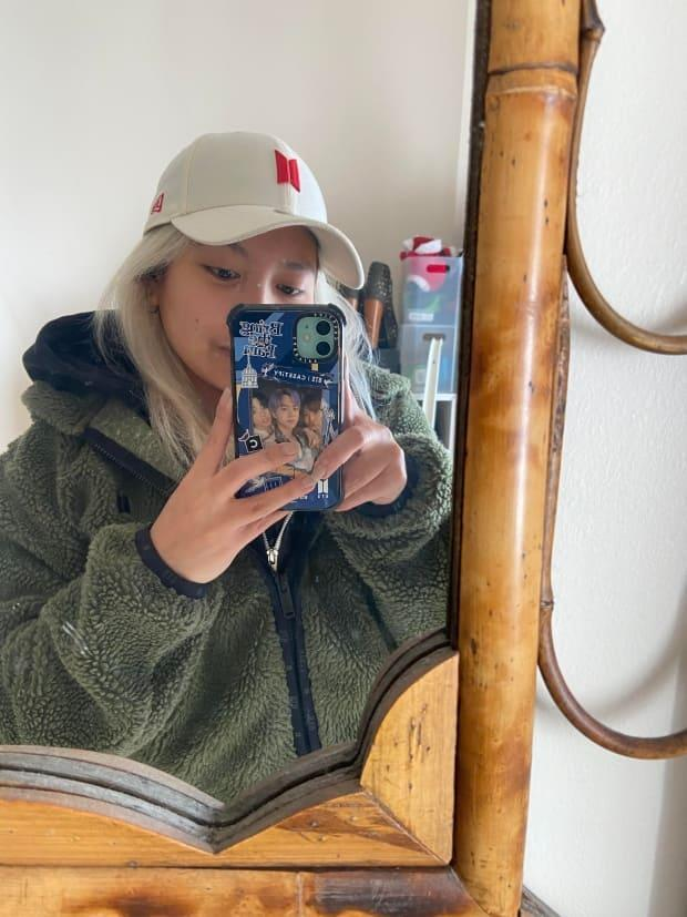 Theresa Baladad shows her phone, which is branded with BTS accessories. (Submitted by Theresa Baladad - image credit)