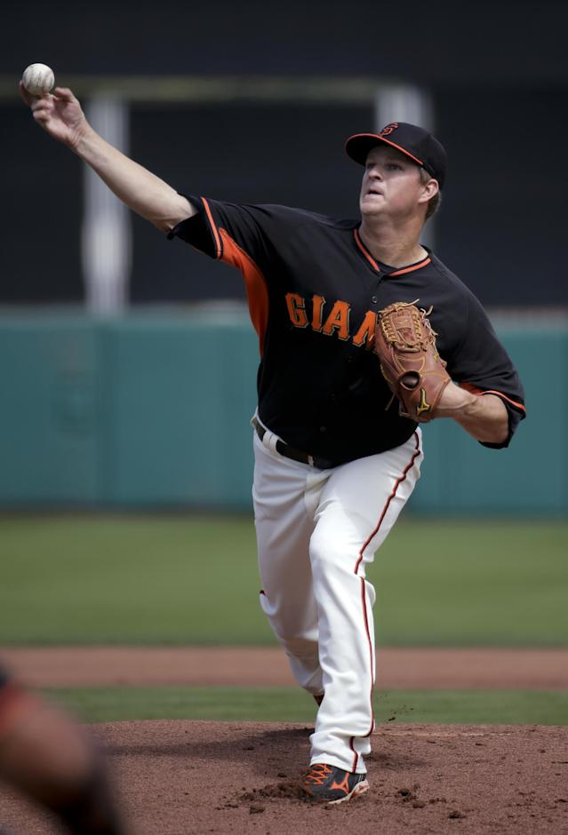 San Francisco Giants starting pitcher Matt Cain throws to the Colorado Rockies during the first inning of a spring exhibition baseball game in Scottsdale, Wednesday, March 26, 2014. (AP Photo/Chris Carlson)