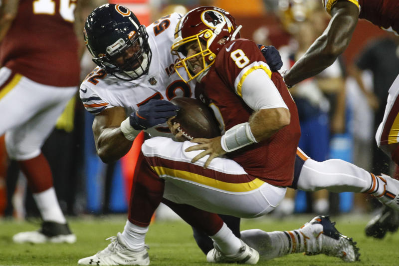 Chicago Bears linebacker Khalil Mack (52) hits Washington Redskins quarterback Case Keenum (8). (AP)