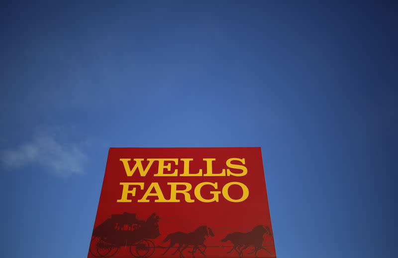 A Wells Fargo logo is seen in the Chicago suburb of Evanston, Illinois, U.S. on February 10, 2015. REUTERS/Jim Young/File Photo