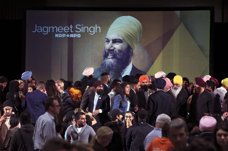 A photograph of Jagmeet Singh is projected on a screen behind a full stage of supporters after Singh won the leadership of the New Democratic Party, October 1, 2017.  (Andrew Francis Wallace via Getty Images)