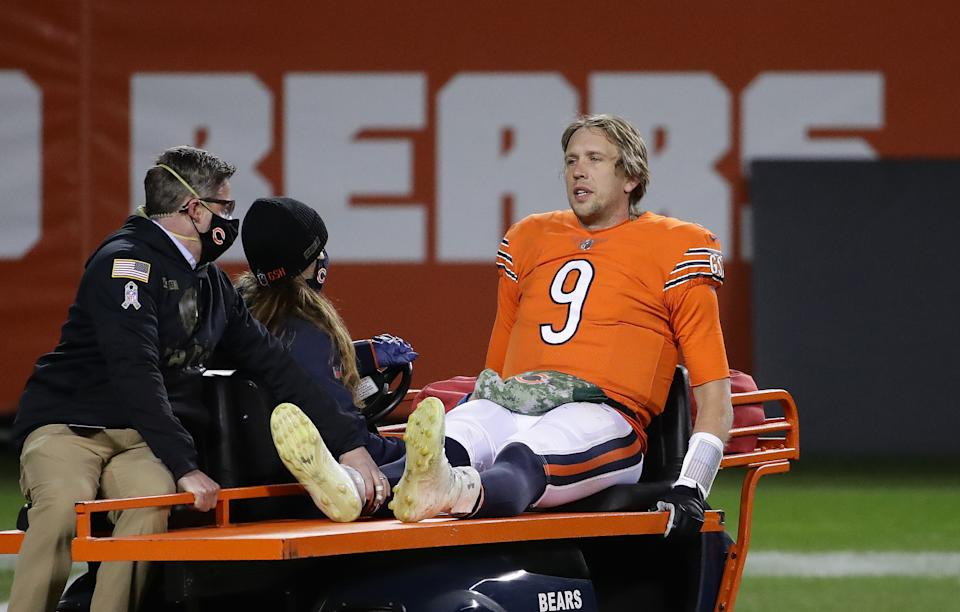CHICAGO, ILLINOIS - NOVEMBER 16:   Nick Foles #9 of the Chicago Bears is carted off of the field after being hit by Ifeadi Odenigbo #95 of the Minnesota Vikings during the fourth quarter of the game at Soldier Field on November 16, 2020 in Chicago, Illinois.  (Photo by Jonathan Daniel/Getty Images)