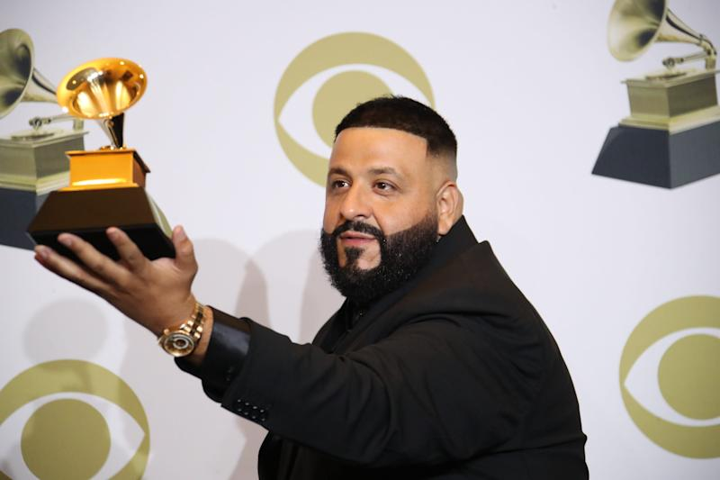 "DJ Khaled poses with the award for best rap/sung collaboration for ""Higher."""