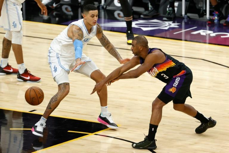 Phoenix guard Chris Paul passes the ball around Los Angeles' Kyle Kuzma in the Suns' 111-94 NBA victory over the Lakers