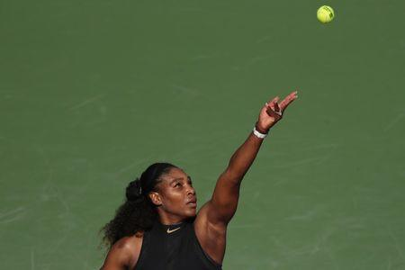 Mar 21, 2018; Key Biscayne, FL, USA; Serena Williams of the United States serves against Naomi Osaka of Japan (not pictured) on day two of the Miami Open at Tennis Center at Crandon Park. Osaka won 6-3, 6-2. Geoff Burke-USA TODAY Sports