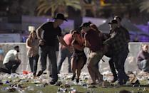 <p>Country music fans help each other flee towards safety. </p>