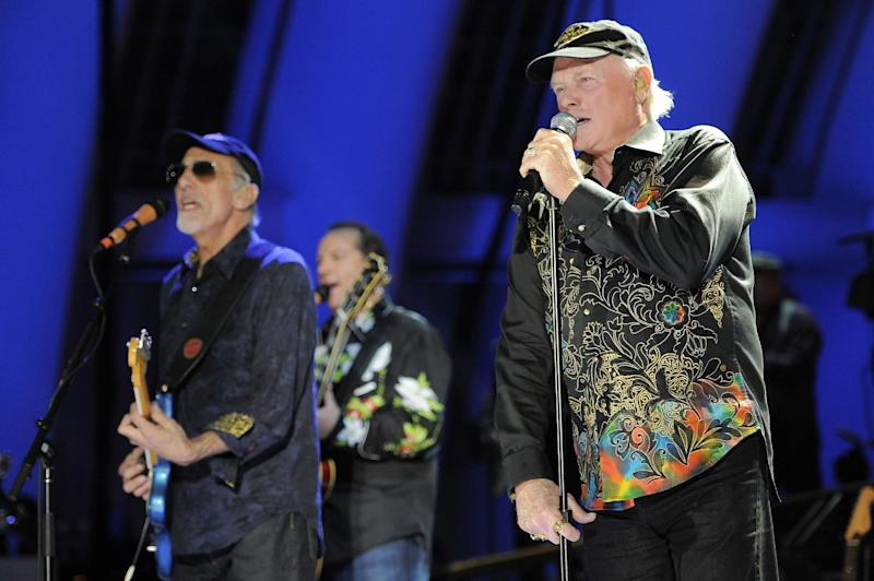 FILE - In this June 2, 2012 file photo, Mike Love, right, of The Beach Boys, performs alongside fellow band member David Marks at the Hollywood Bowl in Los Angeles. Brian Wilson says he felt blindsided by a news release from his Beach Boys bandmate Mike Love that ended the good vibrations on the band's 50th anniversary tour. Wilson says the expectation was that both sides would help craft and approve the news release. That didn't happen and now he thinks it's Love's turn to reach out. (Photo by Chris Pizzello/Invision/AP, File)