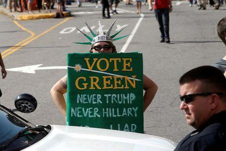 A Green Party supporter stands in a costume as Republican presidential nominee Donald Trump's motorcade passes on the way to a campaign rally in Asheville, North Carolina, U.S., September 12, 2016. REUTERS/Mike Segar