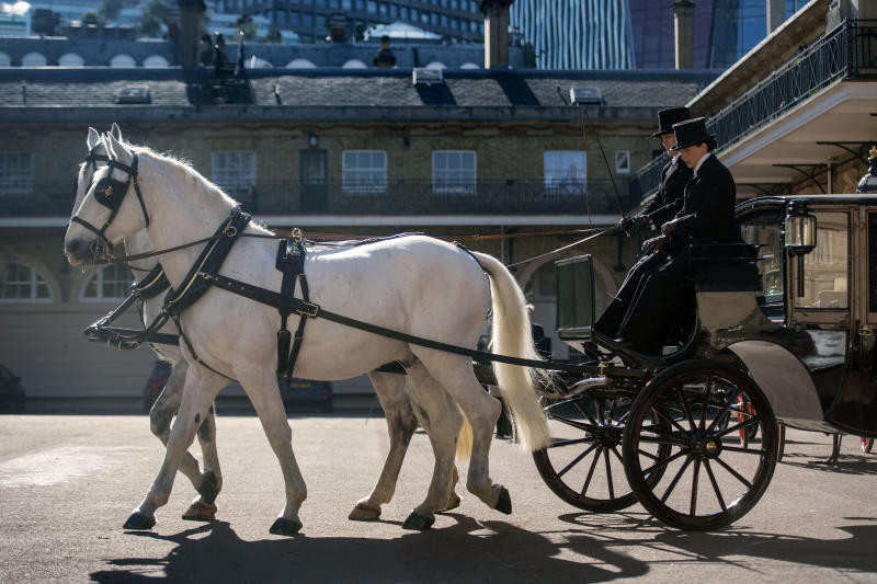 Two Windsor Greys, which will pull the carriage at the wedding of Britain's Prince Harry and Meghan Markle, during preparations in the Royal Mews at Buckingham Palace in London, Tuesday May 1, 2018. Prince Harry and Meghan Markle will tie the knot at St. George's Chapel in Windsor, southern England on May 19, with about 600 guests and some 2,600 neighbours, staff and specially selected members of the public greeting the happy couple outside the chapel. The Scottish State Coach will be used in the case of wet weather and the Ascot Landau open carriage used if it turns out to be a sunny day. (Victoria Jones/Pool via AP)