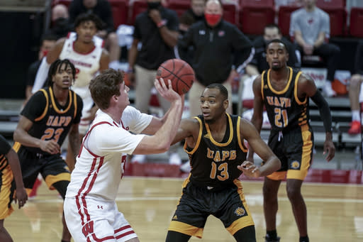 Wisconsin's Nate Reuvers (35) looks for a shot as Arkansas-Pine Bluff's Robert Boyd (13) defends during the second half of an NCAA college basketball game Friday, Nov. 27, 2020, in Madison, Wis. Wisconsin won 92-58. (AP Photo/Andy Manis)