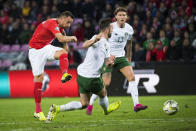 Switzerland's forward Haris Seferovic, left, scores the first goal of the game against Republic of Ireland, during their Euro 2020 qualifying Group D soccer match at the Stade de Geneve, in Geneva, Switzerland, Tuesday, Oct. 15, 2019. (Jean-Christophe Bott/Keystone via AP)