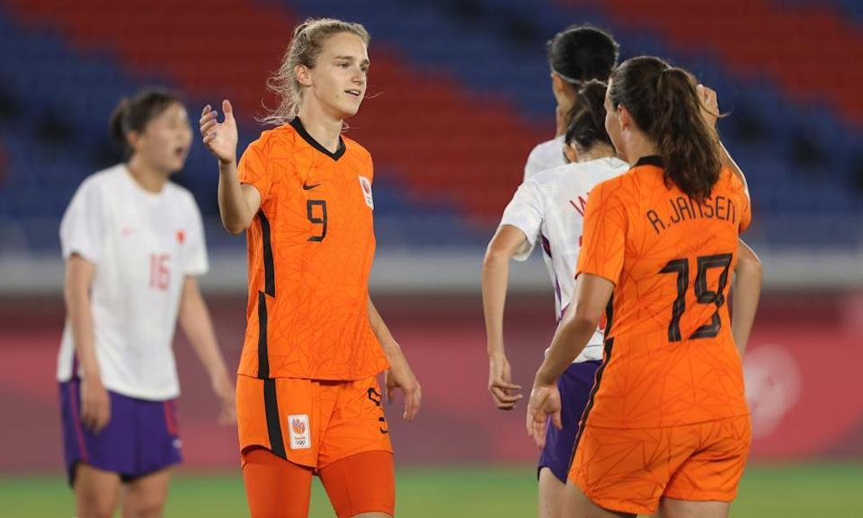 Vivianne Miedema celebrates with Renate Jansen after scoring against China. She has a record eight goals at this tournament.