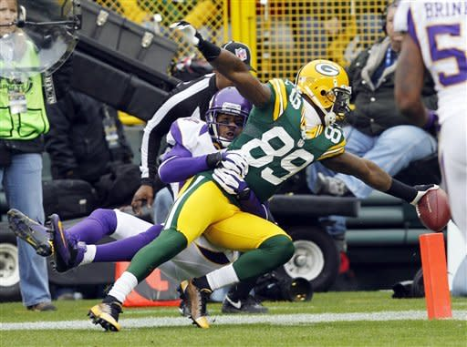 ADDS THAT THE PLAY WAS CALLED BACK ON A HOLDING CALL - Minnesota Vikings cornerback A.J. Jefferson cannot stop Green Bay Packers wide receiver James Jones (89) from crossing the goal line after catching a touchdown pass during the first half of an NFL football game Sunday, Dec. 2, 2012, in Green Bay, Wis. The play was called back on a holding call. (AP Photo/Mike Roemer)