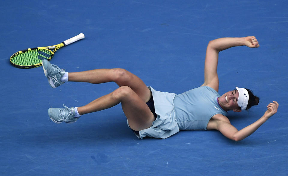 United States' Jennifer Brady falls as she celebrates after defeating Karolina Muchova of the Czech Republic in their semifinal match at the Australian Open tennis championship in Melbourne, Australia, Thursday, Feb. 18, 2021.(AP Photo/Andy Brownbill)